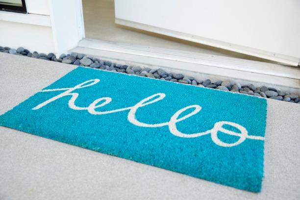Doormat and open door