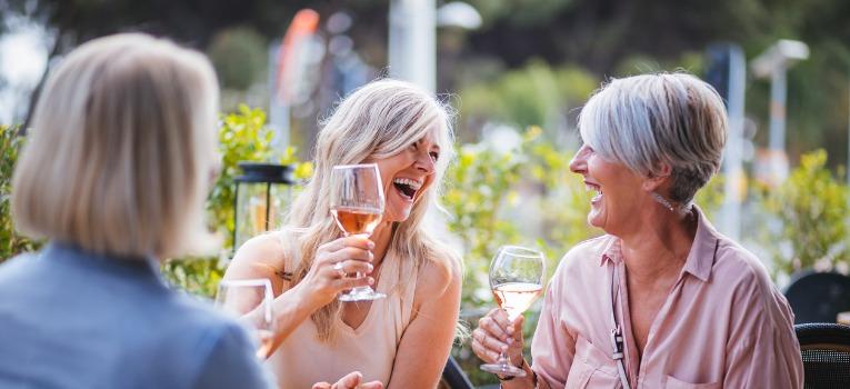 Mature ladies enjoying happy hour