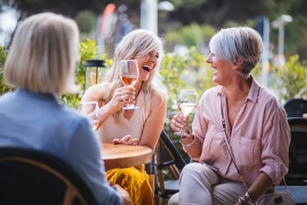 Mature ladies enjoying happy hour